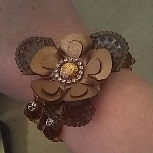 Jewelry - Beaded bracelet with a layered flower on top.